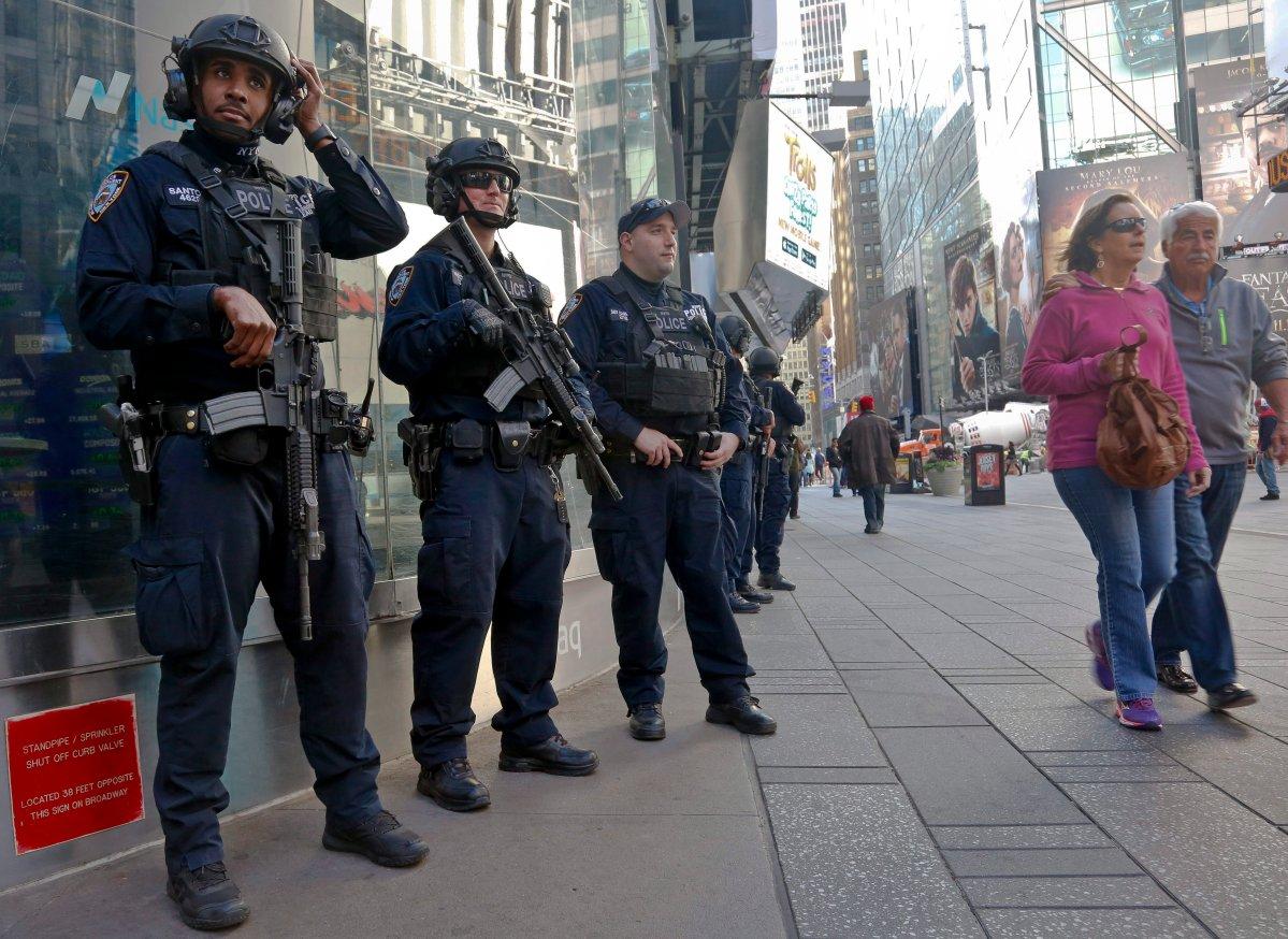 NYPD anti-terror police patrol Times Square, Friday Nov. 4, 2016, in New York.  (AP Photo/Bebeto Matthews).