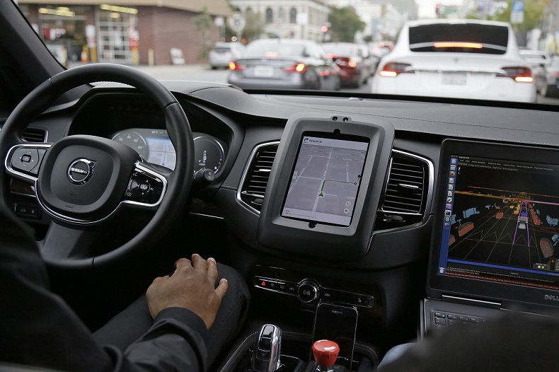 An Uber driverless car waits in traffic during a test drive in San Francisco in late 2016.