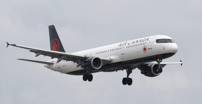 An Air Canada flight lands at Toronto Pearson International Airport in Toronto, Oct. 15, 2017.