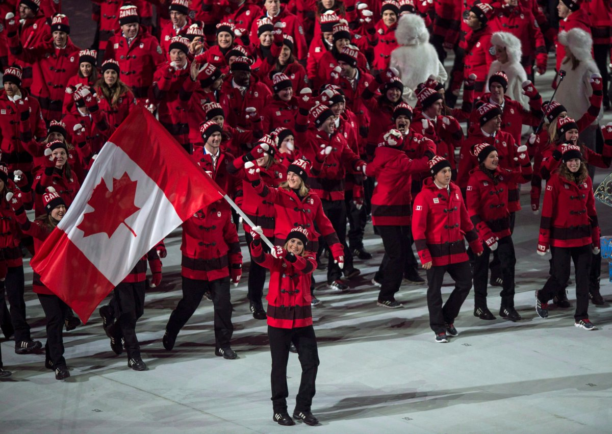 Hayley Wickenheiser leads the Canadian team into the stadium during opening ceremonies at the Sochi Winter Olympics in Sochi, Russia, on February 7, 2014.