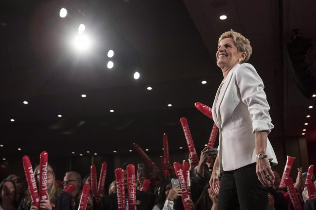 Ontario Premier Kathleen Wynne takes to the stage before addressing the Ontario Liberal Party's annual general meeting in Toronto, Feb. 3, 2018. Wynne's office said it was unaware of the allegations made by the woman.