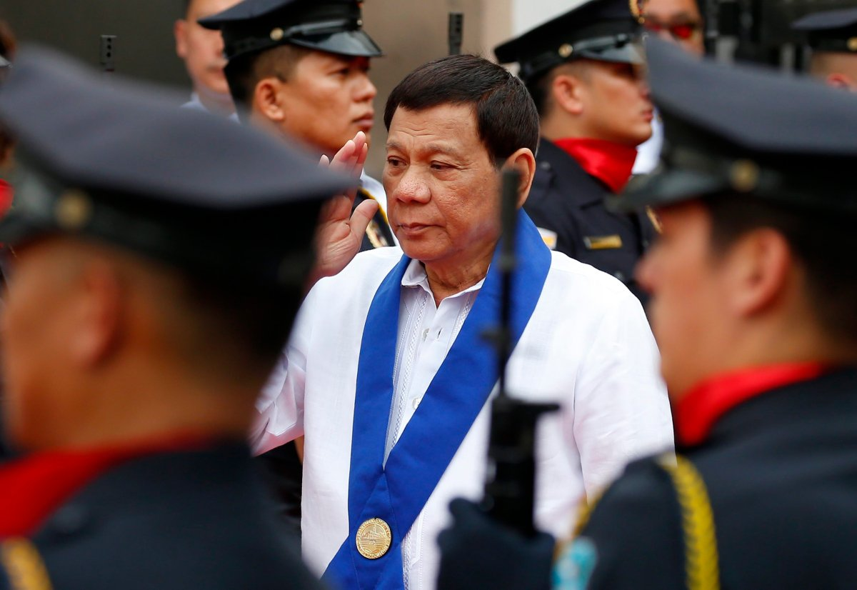 """Philippine President Rodrigo Duterte salutes customs police as he arrives to witness the destruction of a fleet of 20 used luxury cars and SUVs as part of the 116th anniversary celebration of the Bureau of Customs in Manila, Philippines Tuesday, Feb. 6, 2018. President Rodrigo Duterte has ordered a stop to all foreign scientific research missions in a vast expanse of waters off the country's northeast and asked navy ships and air force planes to """"chase out"""" fishing and research vessels in the region, an official said Tuesday."""