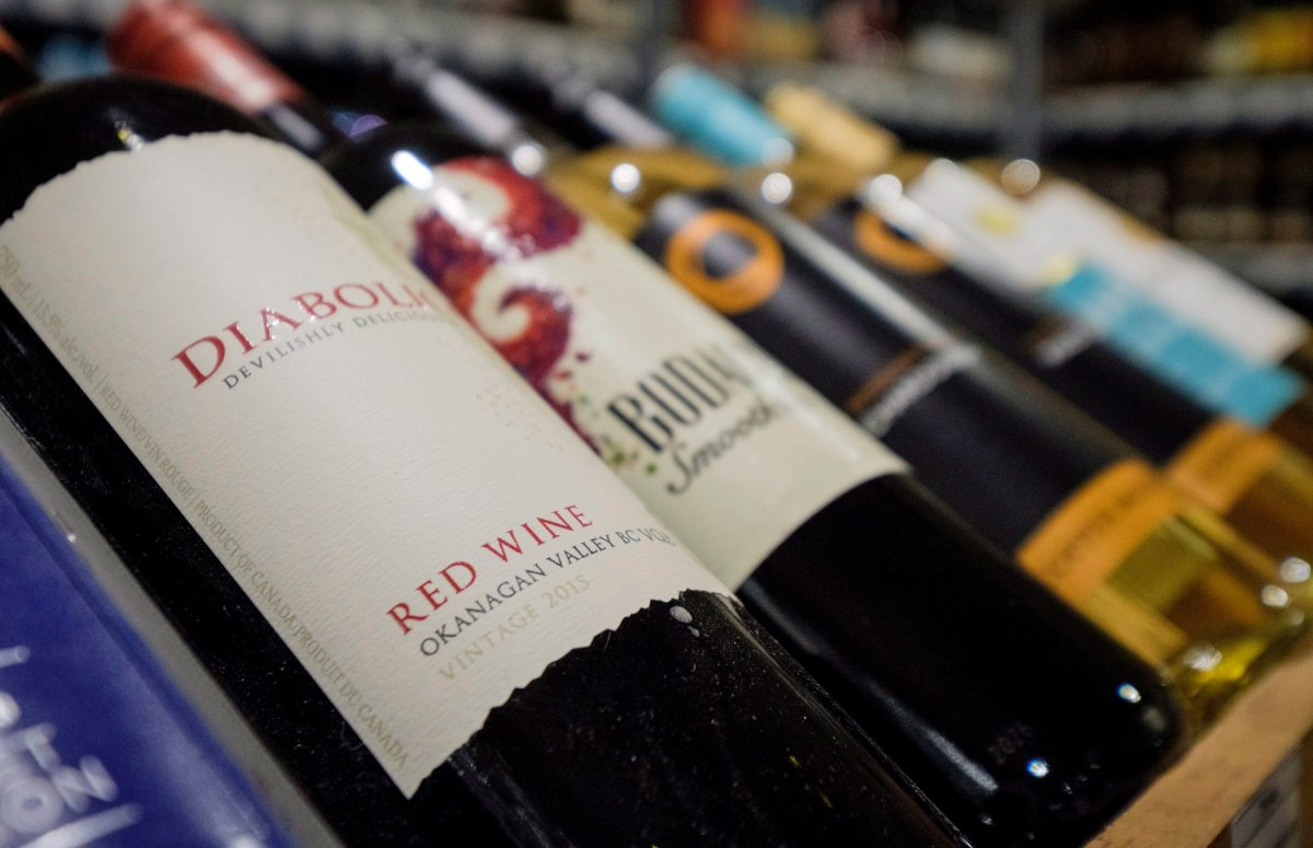 Bottles of British Columbia wine on display at a liquor store in Cremona, Alta., Wednesday, Feb. 7, 2018. Alberta is banning the import of British Columbia wines in response to what Alberta Premier Rachel Notley sees as moves to try to scuttle the Trans Mountain pipeline project. THE CANADIAN PRESS/Jeff McIntosh.