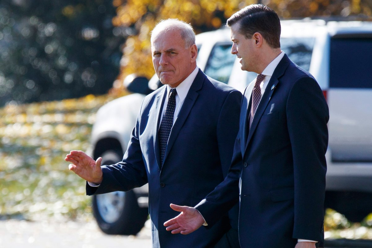In this Nov. 29, 2017 file photo, White House Chief of Staff John Kelly, left, walks with White House staff secretary Rob Porter to board Marine One on the South Lawn of the White House in Washington.