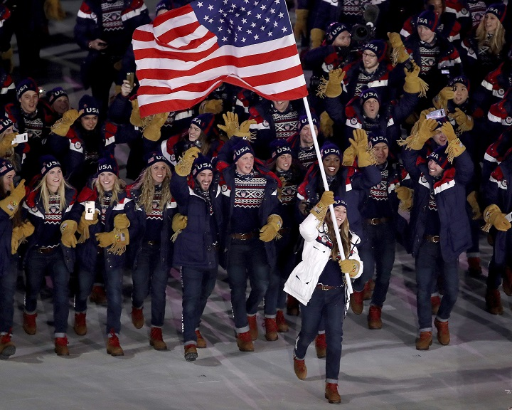 Olympic flag bearer Erin Hamlin will not be making the trip to the White House Friday as Donald Trump hosts athletes from the 2018 Winter Olympics.