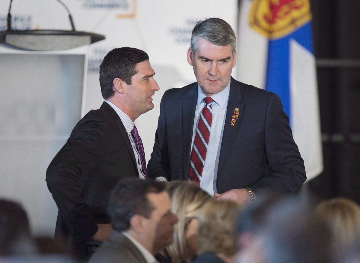 Premier Stephen McNeil, right, chats with Geoff MacLellan, government house leader, before he delivers the state-of-the-province speech at a business luncheon in Halifax on Wednesday, Feb. 7, 2018.
