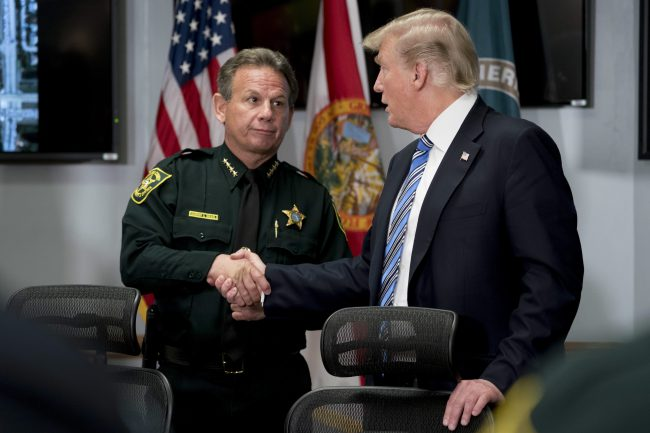 President Donald Trump shakes hands with Broward County Sheriff Scott Israel in Pompano Beach, Fla.,Feb. 16, 2018, following Wednesday's shooting at Marjory Stoneman Douglas High School, in Parkland, Fla.