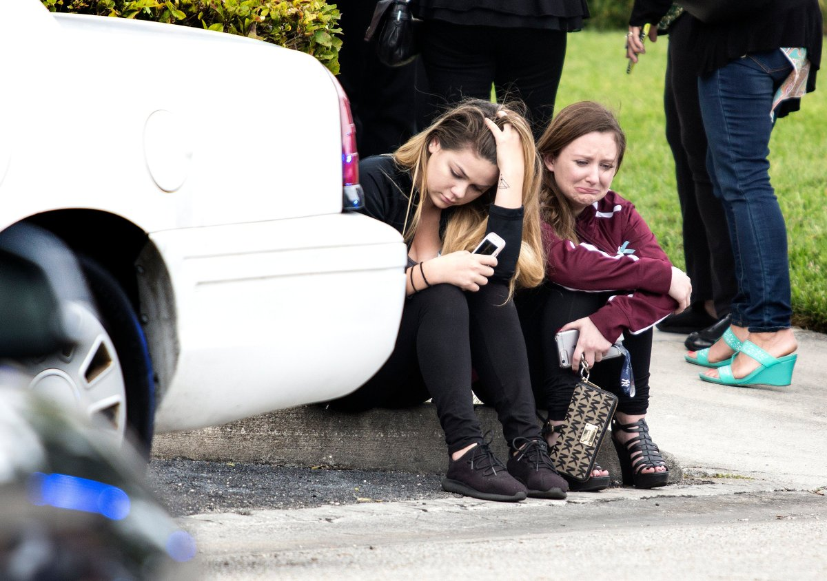 Two girls crying after the viewing service for Gina Montalto, one of the victims of the shooting, in the Kraeer Funeral Home in Coral Springs.