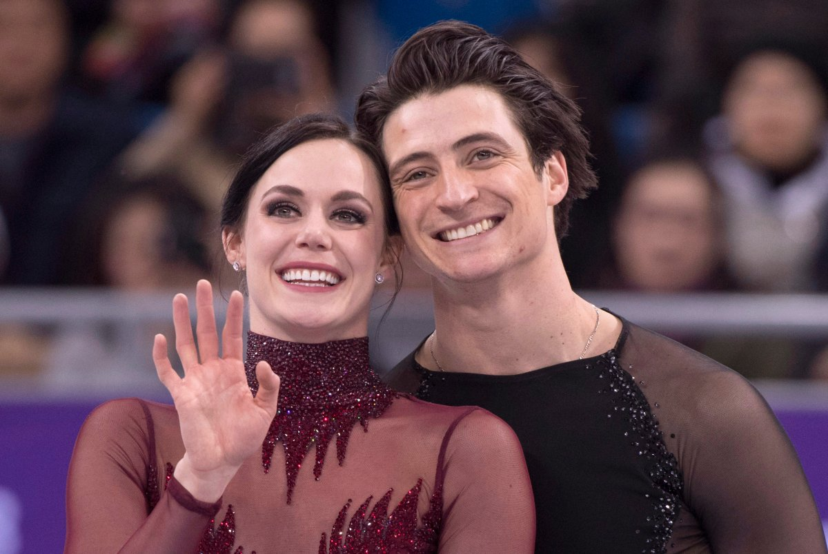 Ice dance gold medalists Canada's Tessa Virtue and Scott Moir look up to the crowd during victory ceremonies at the Pyeongchang Winter Olympics Tuesday, February 20, 2018 in Gangneung, South Korea.