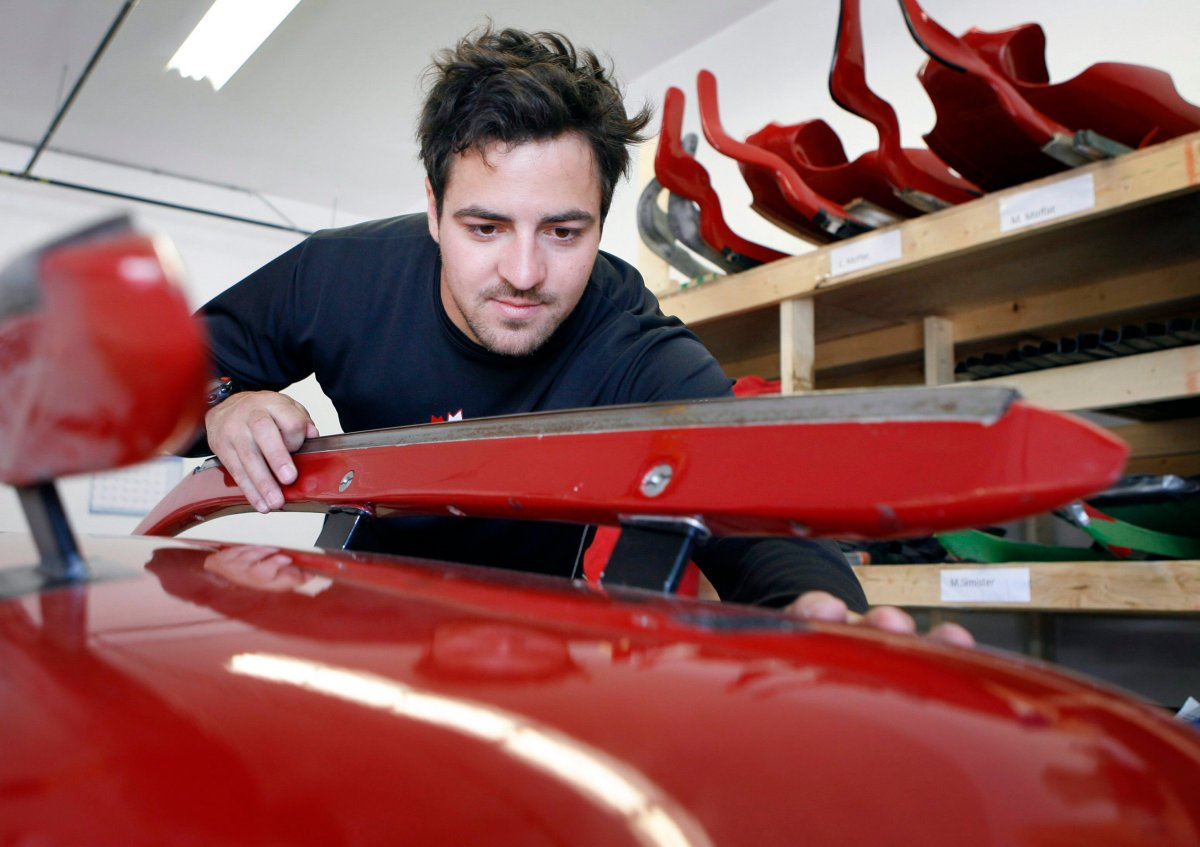 Luge athlete Sam Edny, works on his luge sled at the Canadian luge team's sled factory in Calgary, Tuesday, July 21, 2009.