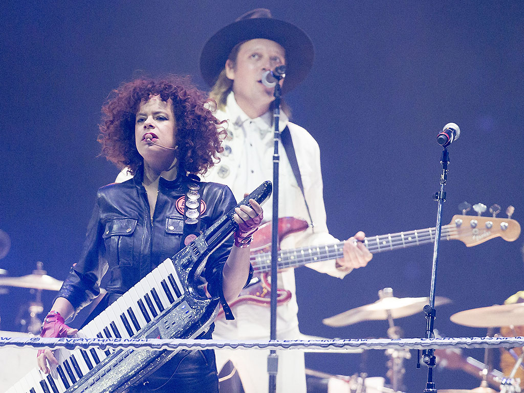 Régine Chassagne and Win Butler of Arcade Fire perform at the Air Canada Centre on November 3, 2017.