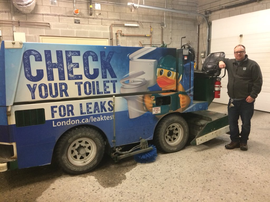 Art Johnston, 46, stands with the Zamboni he uses at the Earl Nichols Arena in  London. He'll be traveling to Pyeonchang on Sunday.