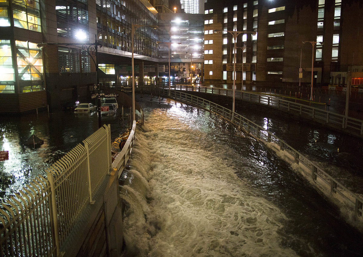 In this Oct. 29, 2012, file photo, seawater floods the entrance to the Brooklyn Battery Tunnel in New York in the wake of Superstorm Sandy.