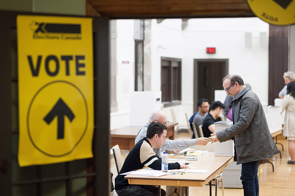 Voters in the 2015 federal election cast ballots in Toronto.