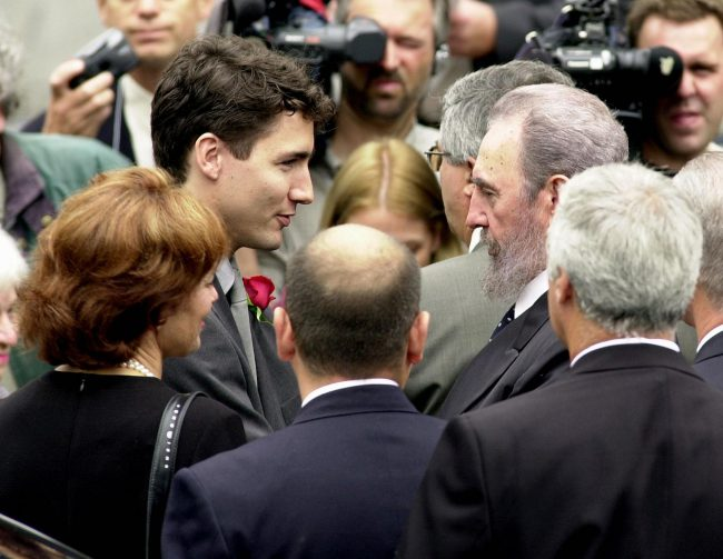 Cuban President Fidel Castro greets Justin Trudeau after arriving at the Notre Dame Basilica for Pierre Trudeau's state funeral, Oct. 3, 2000.