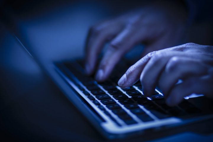 BERLIN, GERMANY - JUNE 22: In this photo Illustration hands typing on a computer keyboard on June 22, 2016 in Berlin, Germany. (Photo Illustration by Thomas Trutschel/Photothek via Getty Images).