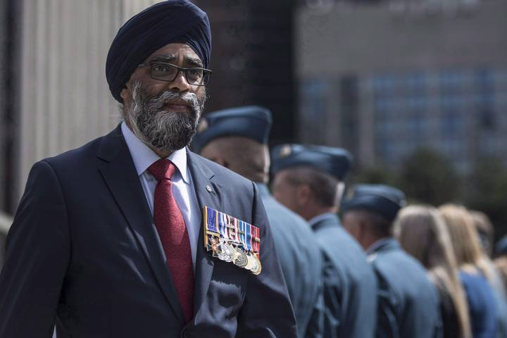 Defence Minister Harjit Sajjan displays his service medals as he leaves a ceremony in which the Royal Canadian Air Force were presented with new ceremonial flags in Toronto on Friday, September 1, 2017.