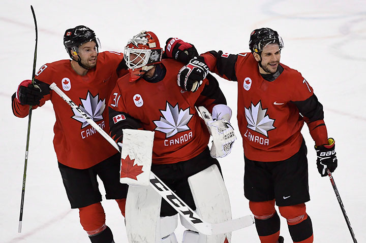 Canada goaltender Kevin Poulin, defenceman Marc-Andre Gragnani and forward Rene Bourque celebrate defeating Finland in the Olympic quarterfinal hockey action at the 2018 Olympic Winter Games in Pyeongchang, South Korea on Feb. 21, 2018.