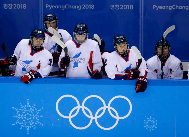 In this Feb. 18, 2018 file photo, North Korea's Jin Ok (32), of the combined Koreas team, joins teammates Park Yoonjung (23), Park Ye-eun (11), Kim Selin (8), and Kim Heewon (12) during the third period of the classification round of the women's hockey game at the 2018 Winter Olympics in Gangneung, South Korea.