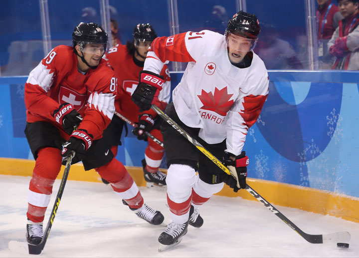 Cody Almond (L) of Switzerland in action against Mason Raymond of Canada during the men's Ice Hockey preliminary round match between Switzerland and Canada at the Kwandong Hockey Centre in Gangneung during the PyeongChang Winter Olympic Games 2018, South Korea, 15 February 2018.