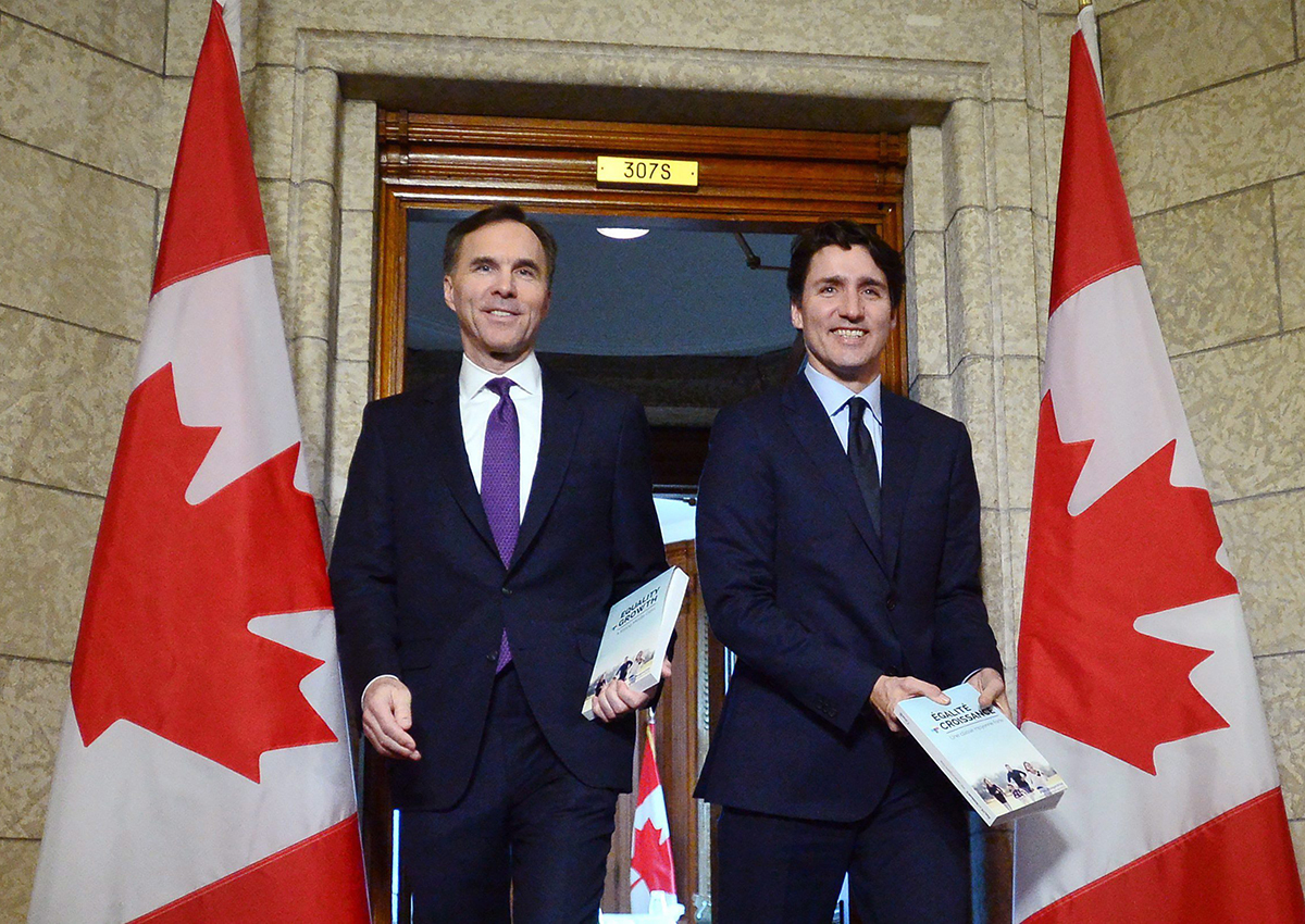 Bill Morneau and Justin Trudeau leave the prime minister's office to table the federal budget in the House of Commons in Ottawa on Tuesday, Feb.27, 2018.