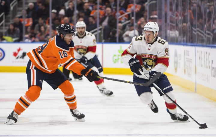 Florida Panthers right wing Evgenii Dadonov (63) and Edmonton Oilers centre Ryan Strome (18) battle for the puck during first period NHL action in Edmonton, Alta., on Monday February 12, 2018.