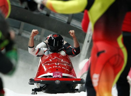 Canada's Alexander Kopacz and Justin Kripps celebrate following their run in the two-man bobsleigh finals in Pyeongchang, South Korea on Feb. 19, 2018.