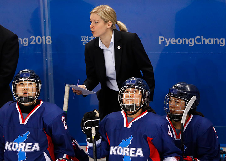 Korea's head coach Sarah Murray watches on during a preliminary round match against Sweden at the Kwandong Hockey Centre, Gangneung, South Korea on Feb. 12, 2018.