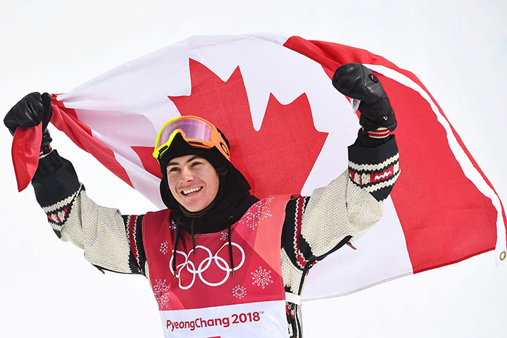 Gold medallist Sebastien Toutant celebrates following the men's snowboard big air final at the 2018 Winter Olympic Games in Pyeongchang, South Korea, Feb. 24, 2018.