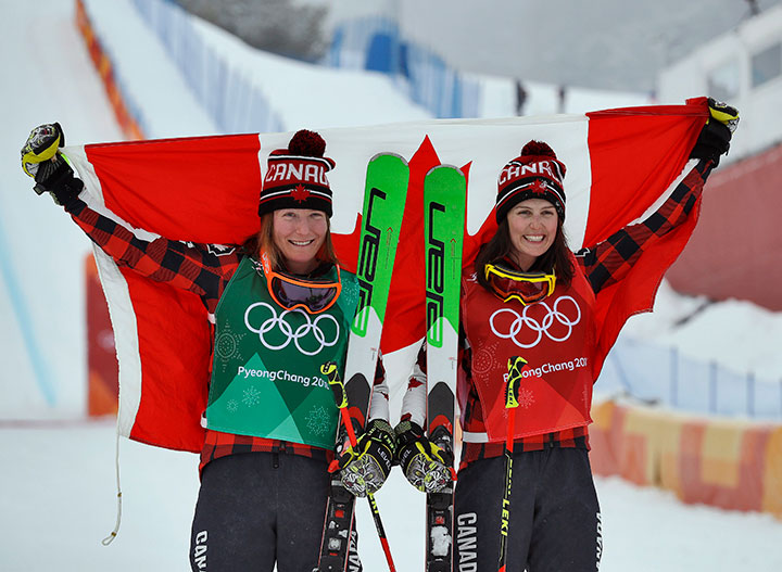 Canada's gold medallist Kelsey Serwa and silver medallist Brittany Phelan celebrate after the women's ski cross final at the Phoenix Snow Park, in Pyeongchang, South Korea on Feb. 23, 2018.