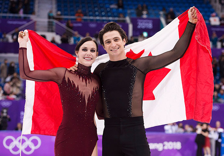 Canada's Tessa Virtue and Scott Moir celebrate their gold medal in ice dance figure skating at the Pyeongchang Winter Olympics, Feb. 20, 2018 in Gangneung, South Korea.