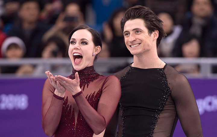 Ice dance gold medalists Canada's Tessa Virtue blows a kiss as Scott Moir looks on during victory ceremonies at the Pyeongchang Winter Olympics, Feb. 20, 2018 in Gangneung, South Korea.