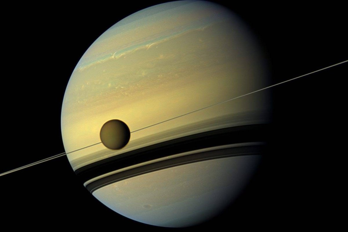 An image provided by NASA shows Saturn's largest moon Titan passing in front of the giant planet in an image made by NASA's Cassini spacecraft.