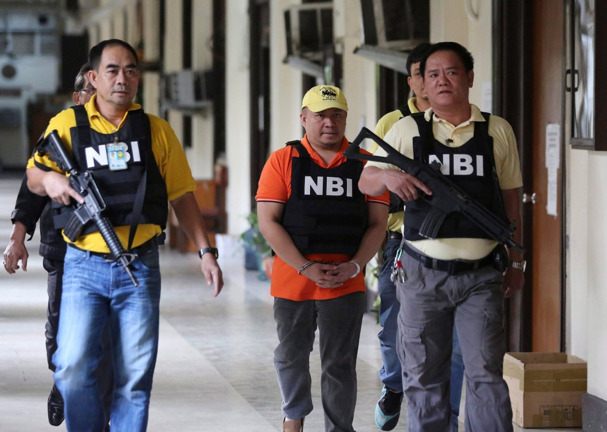 Russell Salic, center, a Filipino doctor accused by U.S. authorities of plotting attacks in New York City with Canadian Abdulrahman El-Bahnasawy. (AP Photo/Aaron Favila).