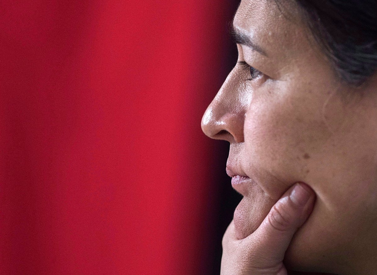 File - Michele Audette, one of the commissioners of the National Inquiry into Missing and Murdered Indigenous Women and Girls, listens as Pamela Fillier testifies about the death of her 16-year-old daughter, Hilary Bonnell, in Moncton, N.B. on Tuesday, Feb. 13, 2018.