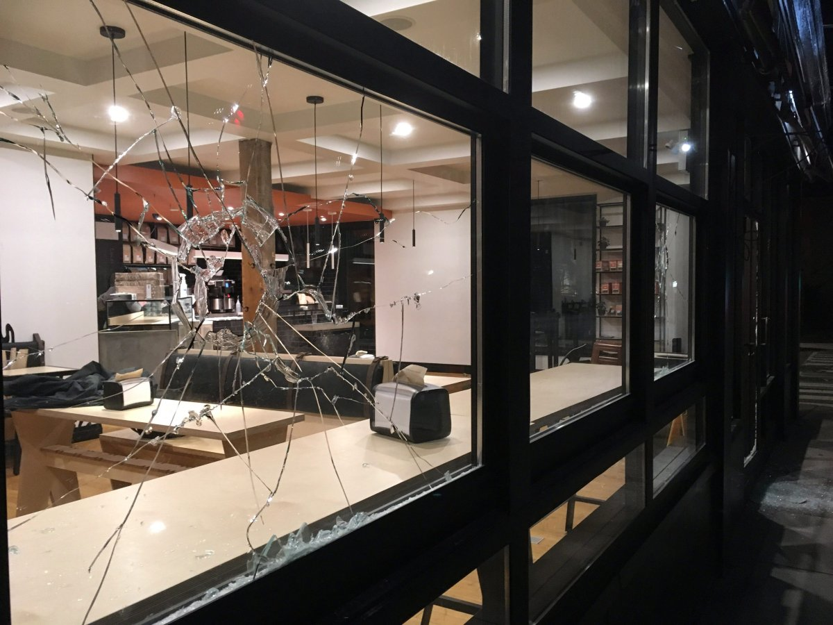 A broken window is seen at Donut Monster, in Hamilton on Saturday, March 3, 2018.
