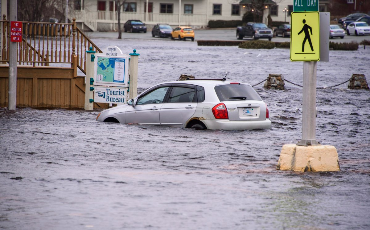 A car sits in sea water up to it's wheel wells at a tourist bureau in Liverpool, Nova Scotia on Saturday March 3, 2018. After another weekend of storm surges battering Nova Scotia's south shore, there're rising concerns from some municipal politicians and citizens about the need for help adapting to climate change.