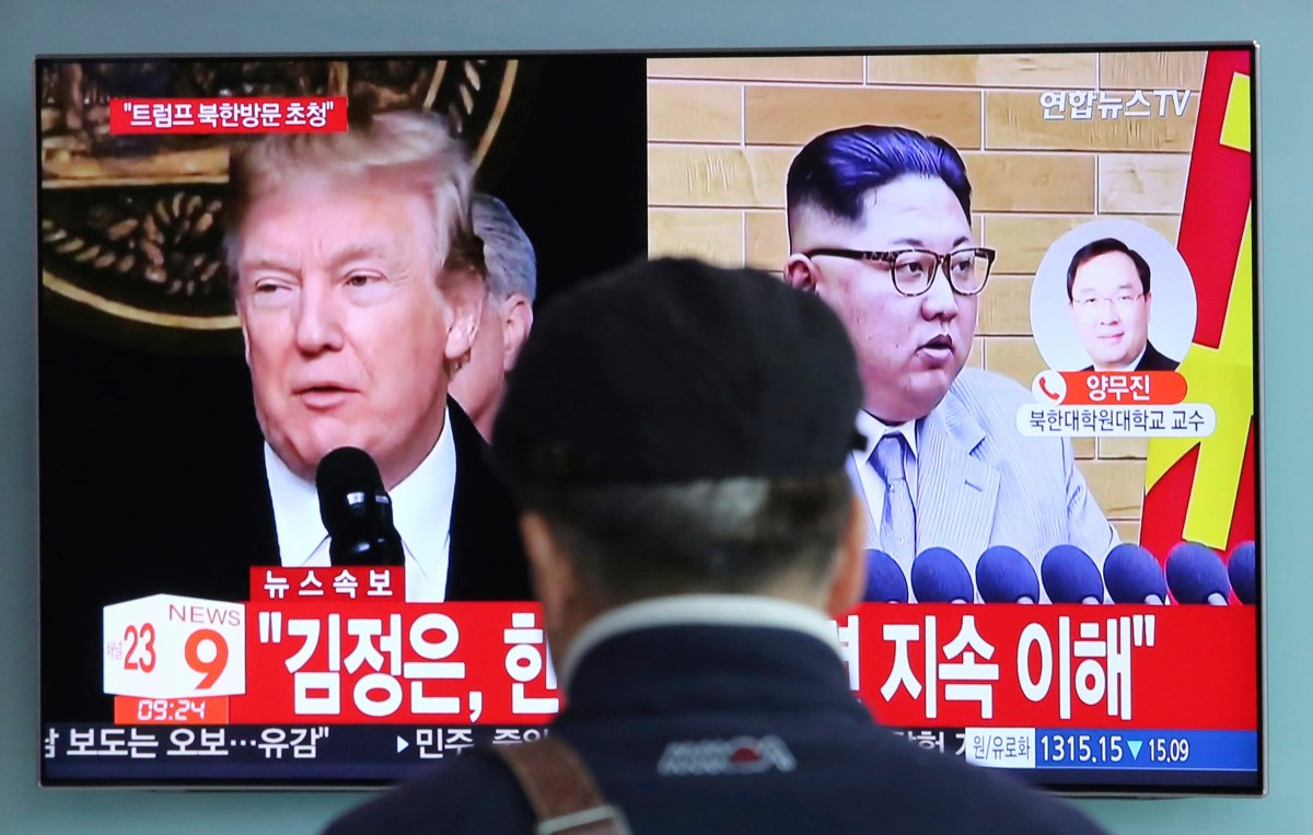 A man watches a TV screen showing North Korean leader Kim Jong Un, right, and U.S. President Donald Trump, left, at the Seoul Railway Station in Seoul, South Korea, Friday, March 9, 2018.