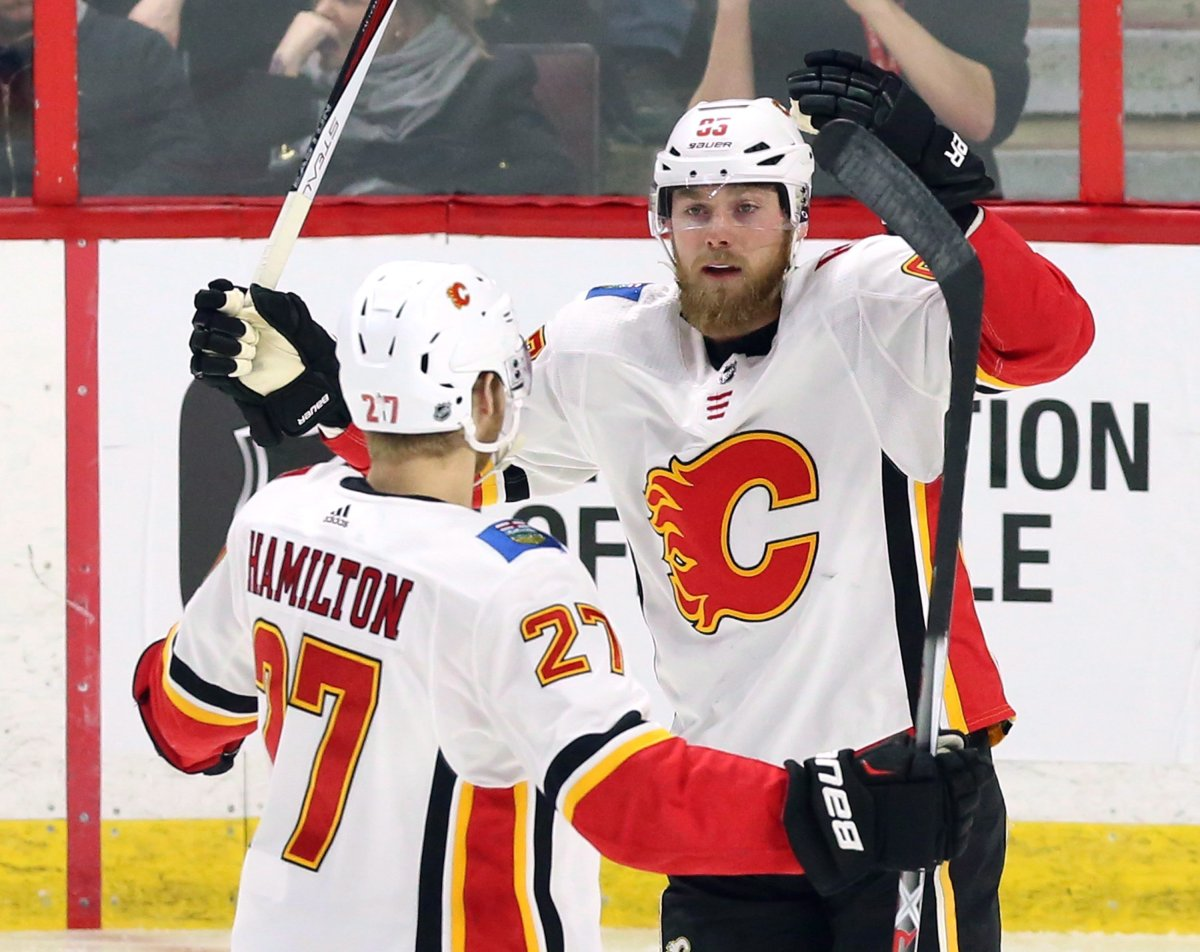 Calgary Flames centre Sam Bennett (93) celebrates his goal against the Ottawa Senators with defenceman Dougie Hamilton (27) during first period NHL hockey action in Ottawa on Friday, March 9 2018. THE CANADIAN PRESS/Fred Chartrand.
