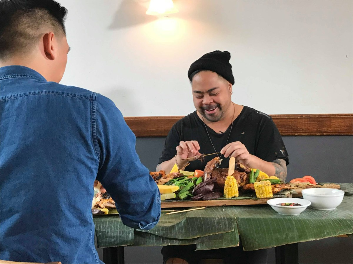 Pierre Anthony Garque shares a kamayan with Mark Sy, co-owner of Kawali Restaurant in Montreal, Sun. March 4, 2018.