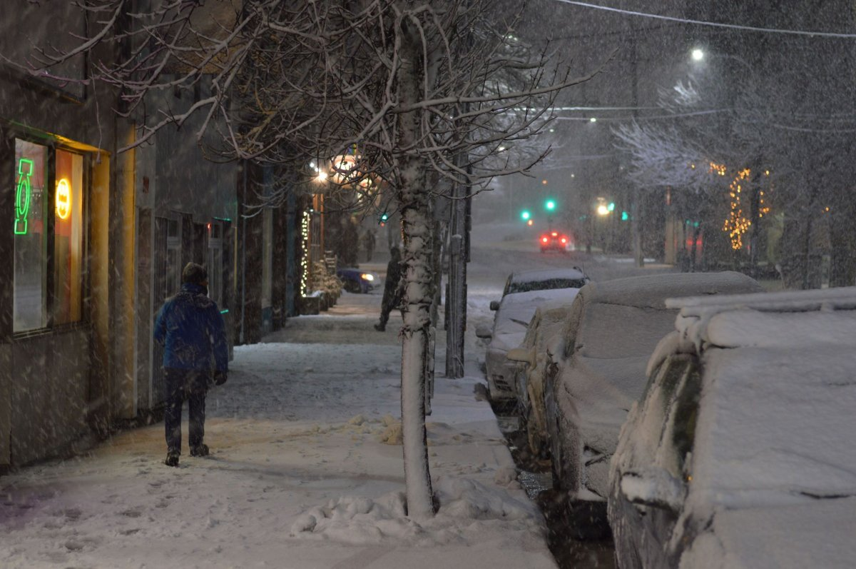 A man makes his way down Gottingen Street in Halifax during a snow storm on March 10, 2018.