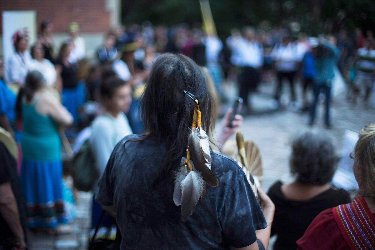 Sixties Scoop survivors and supporters gather for a demonstration at a courthouse on the day of a class-action court hearing in Toronto on Tuesday, August 23, 2016.