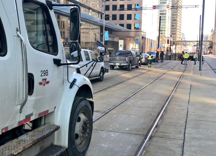 TTC crews and Toronto police were called to the Queens Quay streetcar tunnel Saturday morning after a car got stuck in the tunnel.