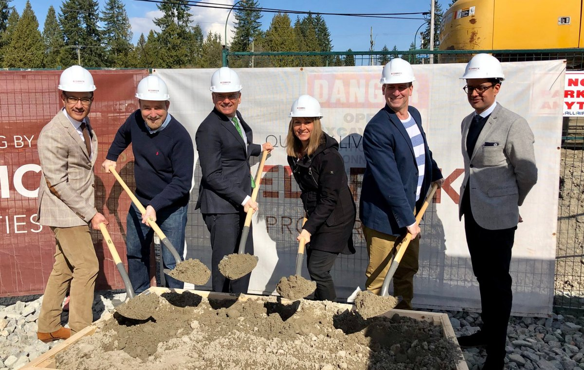Coquitlam mayor Richard Stewart (third from left) joins city councillors and representatives from Redbrick Properties to mark the start of construction on a new market rental housing unit Saturday.