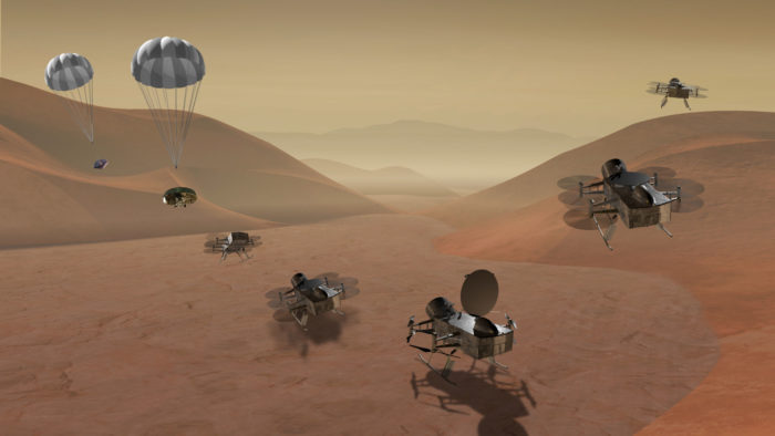 An artist's rendering shows the proposed Dragonfly quadcopter landing on the surface of Saturn's moon Titan, unfolding its rotors and lifting off again to survey the landscape and atmosphere.