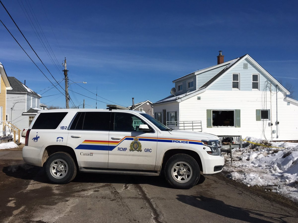 An RCMP cruiser sits in front of the scene of a fatal fire in Springhill, N.S., on March 21, 2018.