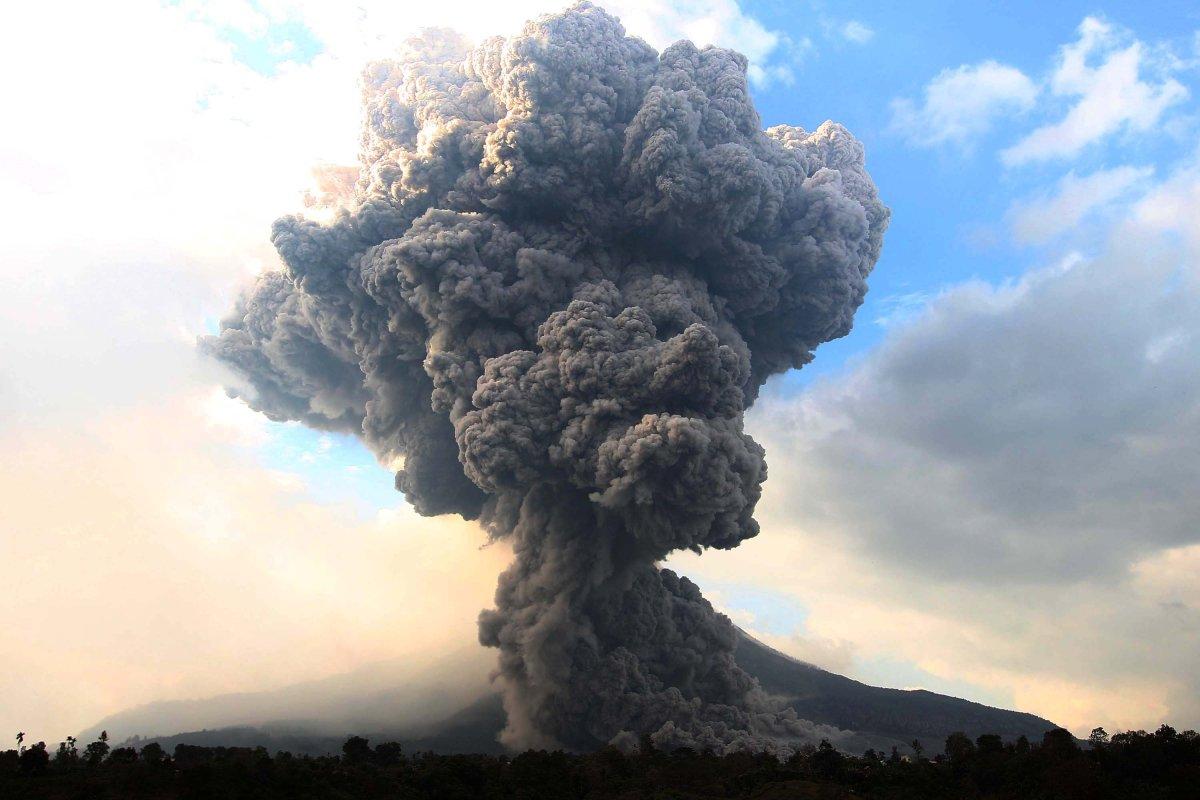 Mount Sinabung spews pyroclastic smoke, seen from Tiga Pancur village in Karo district of North Sumatra, Indonesia on October 13, 2014.