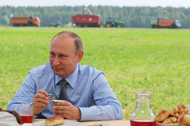 Russia's President Vladimir Putin meets with employees of a livestock facility in Russia's Tver region, July 28, 2016.