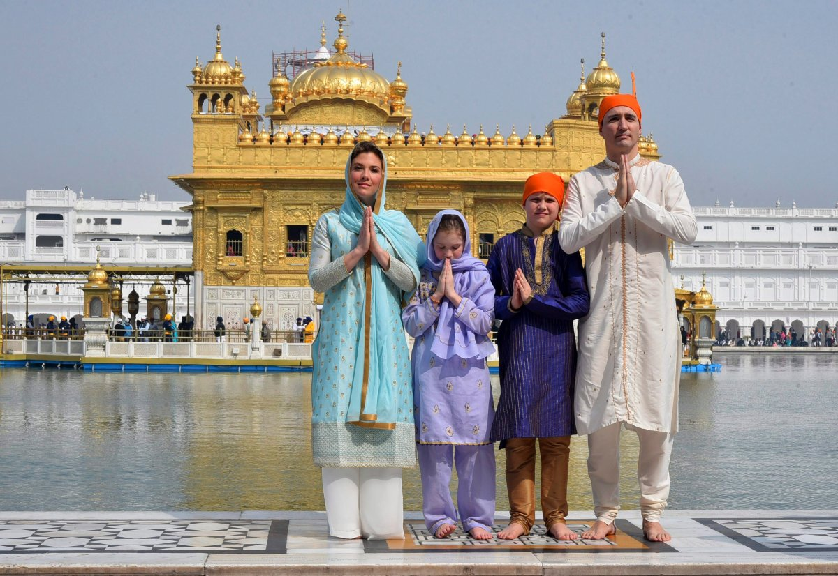 Canadian Prime Minister Justin Trudeau, right, his wife Sophie Gregoire Trudeau, left, their daughter Ella Grace, second left, and son Xavier greet in Indian style during their visit to Golden Temple, in Amritsar, India, Wednesday, Feb. 21, 2018.