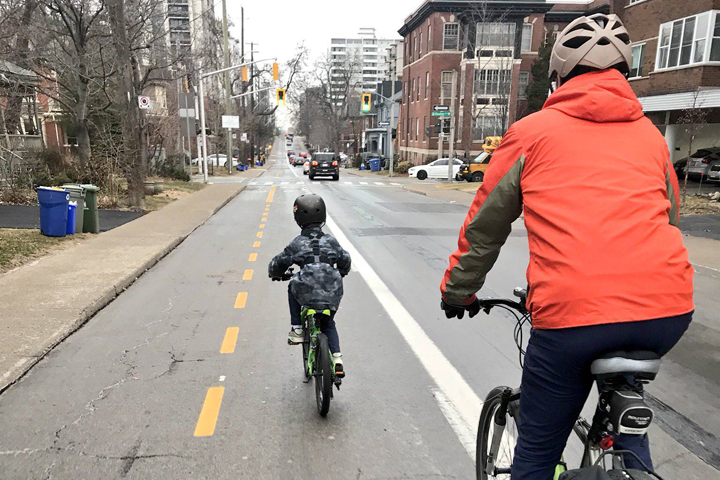 Mayor Fred Eisenberger kicks off Commuting with Council campaign with six-year-old Oliver.